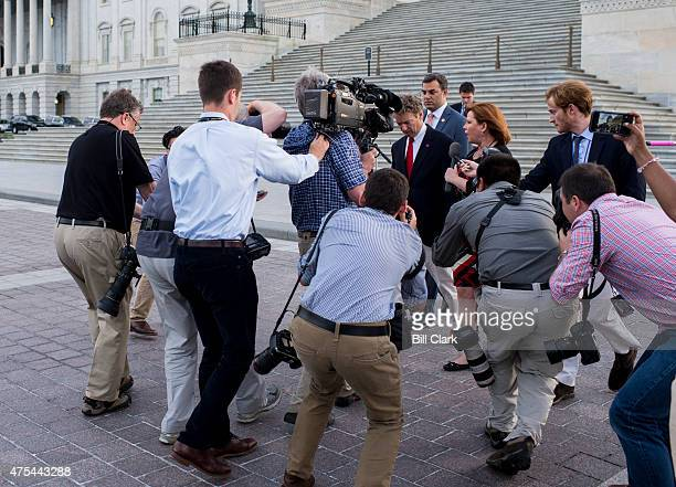 Media surrounds Sen Rand Paul RKy as he leaves the US Capitol with Rep Thomas Massie RKy and Rep Justin Amash RMich after Sen Paul spoke at length on...