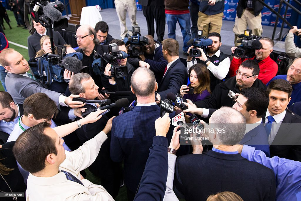Media swarm hall of fame quarterback <a gi-track='captionPersonalityLinkClicked' href=/galleries/search?phrase=Jim+Kelly+-+American+Football+Player&family=editorial&specificpeople=216547 ng-click='$event.stopPropagation()'>Jim Kelly</a> following a press conference announcing Rex Ryan's arrival as head coach of the Buffalo Bills on January 14, 2015 at Ralph Wilson Stadium in Orchard Park, New York.