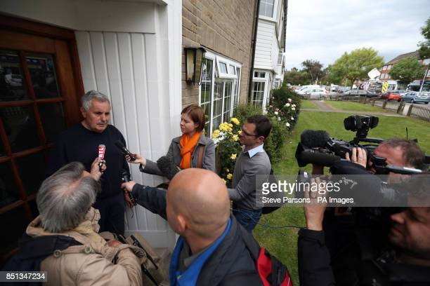 Media talk to neighbour Philip Davies outside the flats in Bray Court in Chessington Surrey where police arrested the brother of the British engineer...