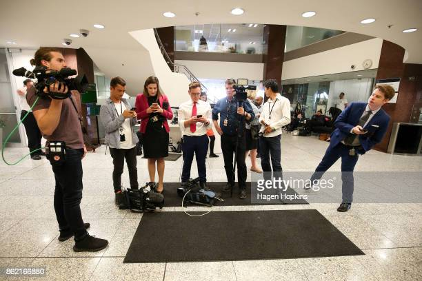 Media wait for leader Winston Peters to make an appearance during a NZ First caucus and board meeting at Parliament on October 17 2017 in Wellington...