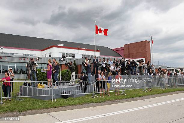 Media wait for the arrival of Prince William Duke of Cambridge and Catherine Duchess of Cambridge as they arrive at MacdonaldCartier International...