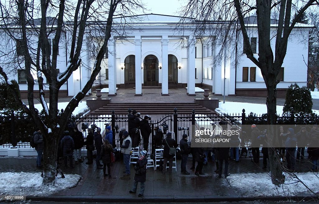Media wait on February 10 2015 outside the presidential residence in Minsk before the start of talks aimed at ending the bloody conflict in eastern...
