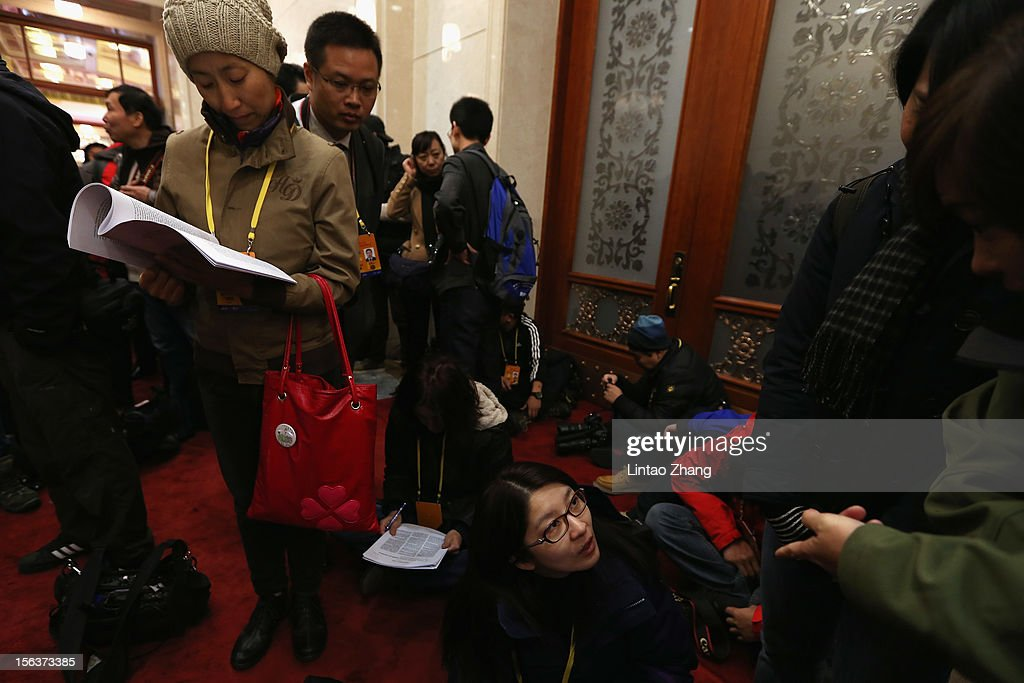 Media wait to be allowed access to the main hall the inside the Great Hall of the People during the closing session of the 18th National Congress of the Communist Party of China (CPC) at the Great Hall of the People on November 14, 2012 in Beijing, China. Members of the Standing Committee of the Political Bureau of the new CPC Central Committee will meet with journalists on November 15, 2012.