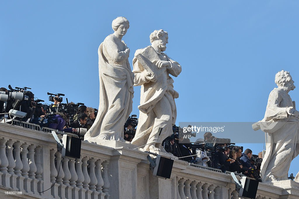 Media work from the colonnade during the inauguration mass of Pope Francis at St Peter's square on March 19, 2013 at the Vatican. World leaders flew in for Pope Francis's inauguration mass in St Peter's Square on Tuesday where Latin America's first pontiff will receive the formal symbols of papal power. AFP PHOTO / VINCENZO PINTO