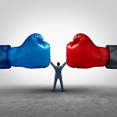 Mediate and legal mediation business concept as a businessman or person separating two boxing glove opposing competitors as an arbitration success symbol for finding common interests to lawfully solve