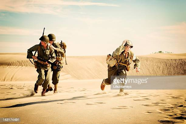WWII Medic and Soldiers Running from Enemy Fire