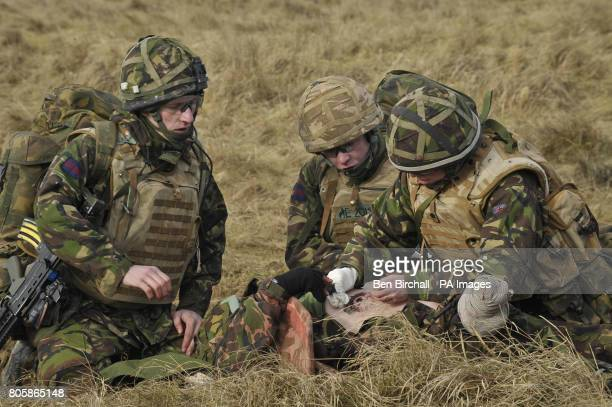 A medic applies first aid to a simulated casualty in preperation for the Medical Emergency Response Team to arrive in a Chinnook helicopter as part...