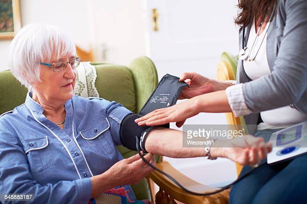 Medic caring for senior woman at home