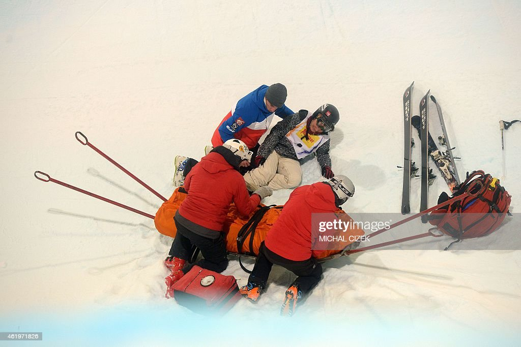 A medic helps Anais Caradeux of France in the u-ramp after she falled during the Women's Ski Halfpipe Final at FIS Freestyle and Snowboarding World Ski Championships 2015 in Kreischberg, Austria on January 22, 2015. Virginie Faivre of Switzerland won ahead Cassie Sharpe of Canada and Mirjiam Jaeger of Switzerland. AFP PHOTO / MICHAL CIZEK