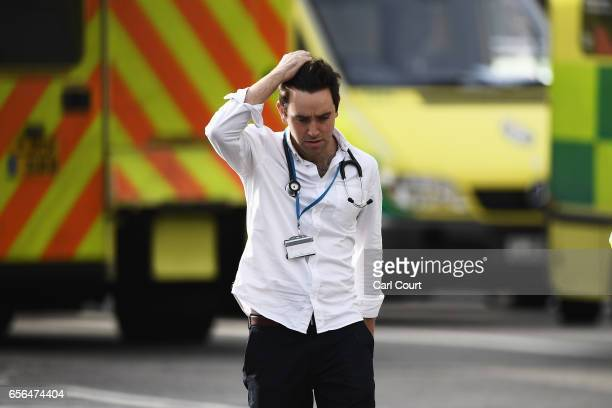 A medic is seen near Westminster Bridge and the Houses of Parliament on March 22 2017 in London England A police officer has been stabbed near to the...