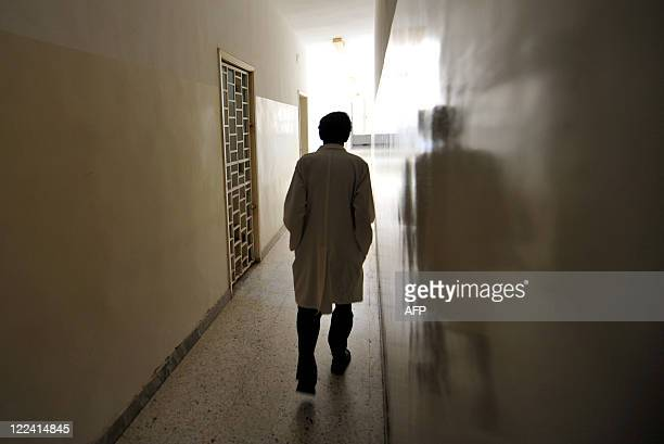 A medic walks down the hall of the Psychiatric hospital in Tripoli on August 28 2011 Tripoli's sole psychiatric hospital already unable to cope under...
