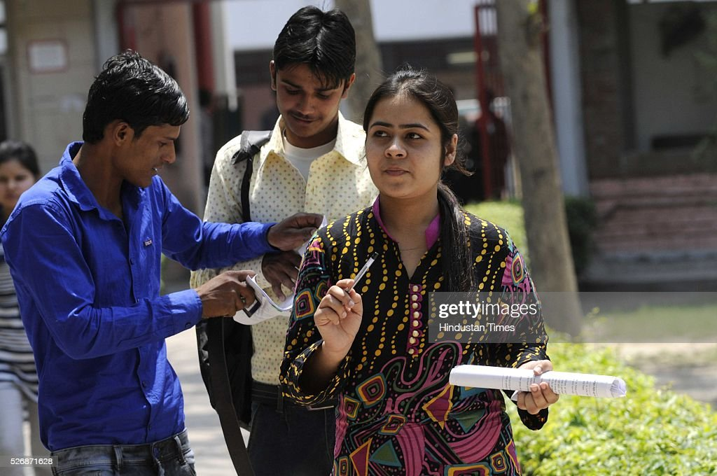 Medical aspirants coming out of the examination hall after appearing the All India Pre-Medical/Pre-Dental Entrance Test (AIPMT), on May 1, 2016 in Noida, India. The All Indian Pre-Medical Test (AIPMT) 2016, being treated as the first phase of the National Eligibility Entrance Test (NEET), was held on Sunday. The competitive examination held for entrance to MBBS and BDS courses across the country was held amidst tight security this year. Students had a proper dress code to adhere to as they were not allowed to enter the examination hall in shoes or carry any kind of stationary with them. Mobile phones were also not allowed