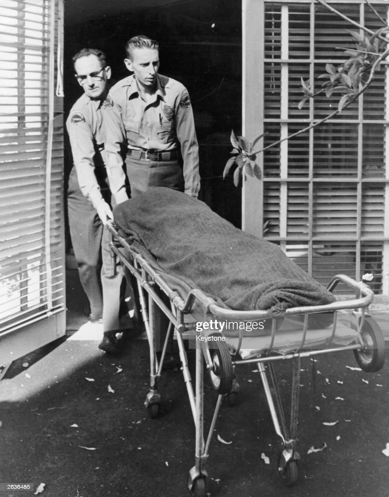 Medical attendents removing the body of Marilyn Monroe (Norma Jean Mortenson or Norma Jean Baker, 1926 - 1962) from her home.