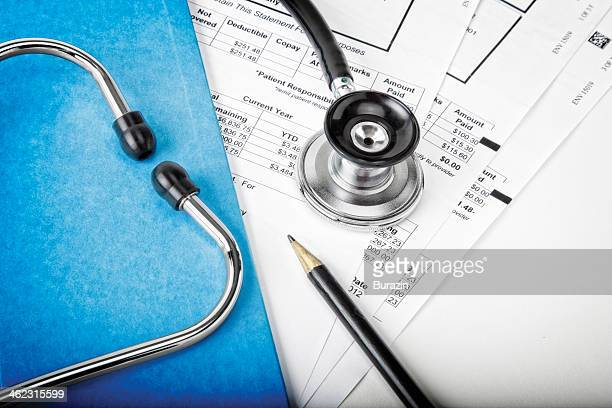 Medical bills with stethoscope