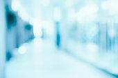 medical blurred background, empty hospital corridor in neon blue light
