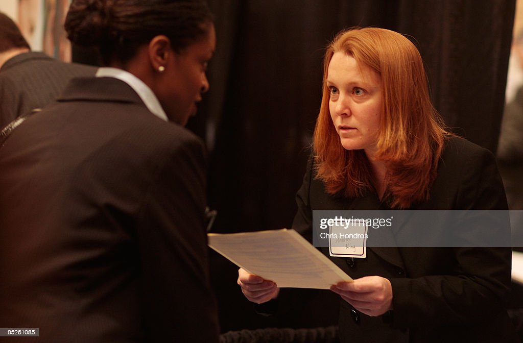 Jennifer King, a job recruiter for a medical center, holds the resume to one of a long line of job hopefuls during the 'Keep America Working' job fair at the Marriot Marquis Hotel in Times Square on March 5, 2009 in New York City. Thousands of job applicants showed up for the fair sponsored by the job placement service Monster.com which will tour nationally around the country. New York City has lost tens of thousands of jobs, a great percentage in the finance sector, due to the economic crisis.