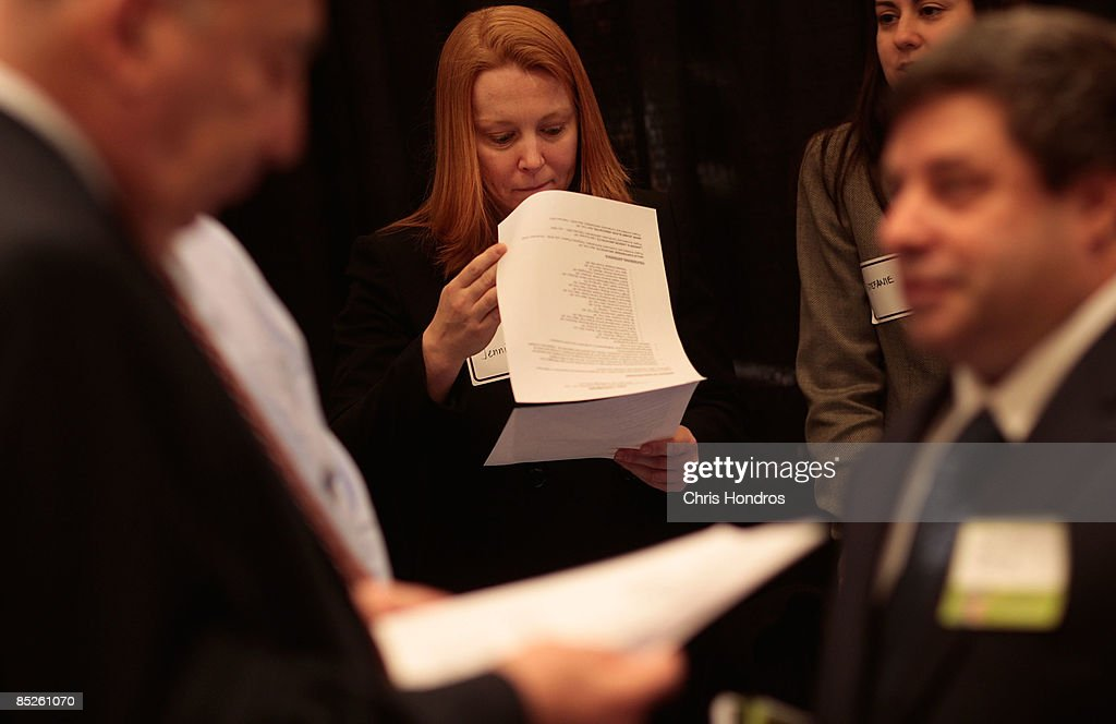 Jennifer King, a job recruiter for a medical center (C) looks over a resume during the 'Keep America Working' job fair at the Marriot Marquis Hotel in Times Square on March 5, 2009 in New York City. Thousands of job applicants showed up for the fair sponsored by the job placement service Monster.com which will tour nationally around the country. New York City has lost tens of thousands of jobs, a great percentage in the finance sector, due to the economic crisis.