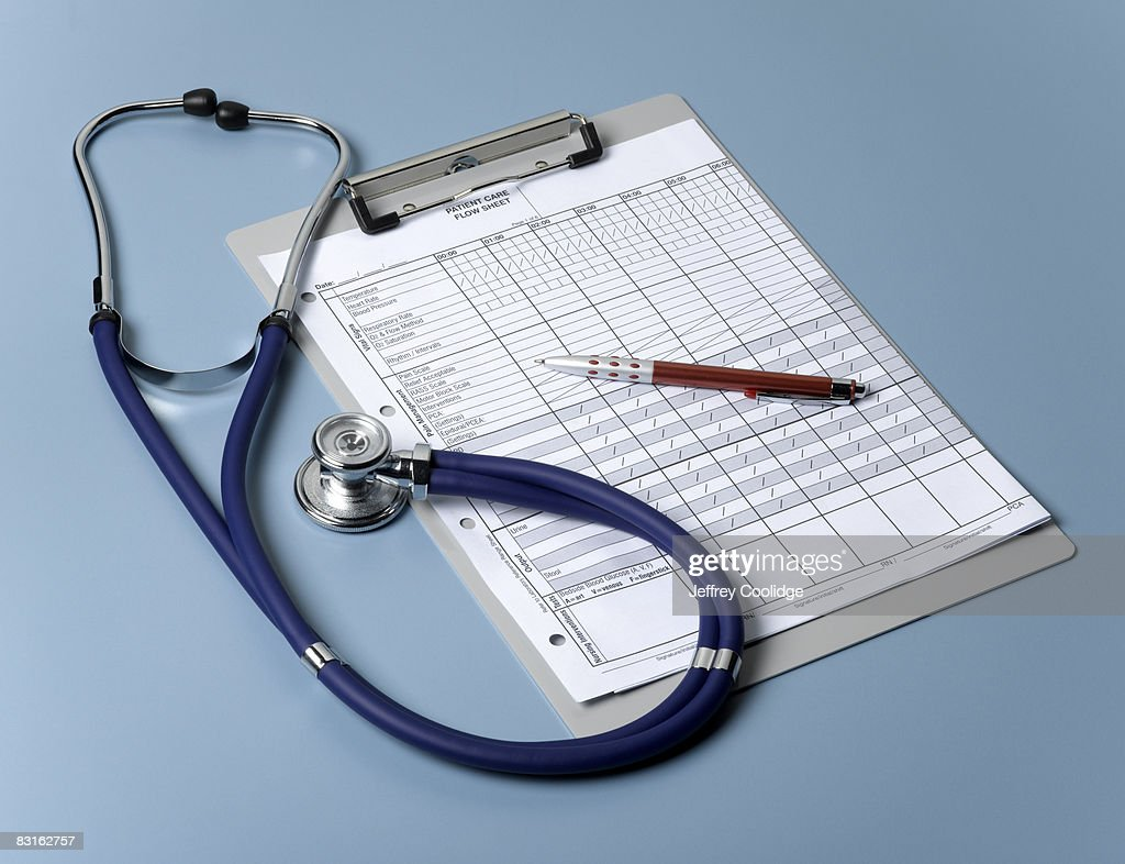Medical chart and stethoscope : Stock Photo