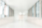 Medical clinic blur background healthcare hospital service center in patient's ward blurry perspective view of interior white room, lab corridor hallway, lobby or walkway for nursing care service fa