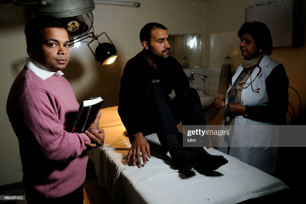 Medical consultant Apoorv Jain with a patientat at Chikitsa Multispecialty Hospital in New Delhi.