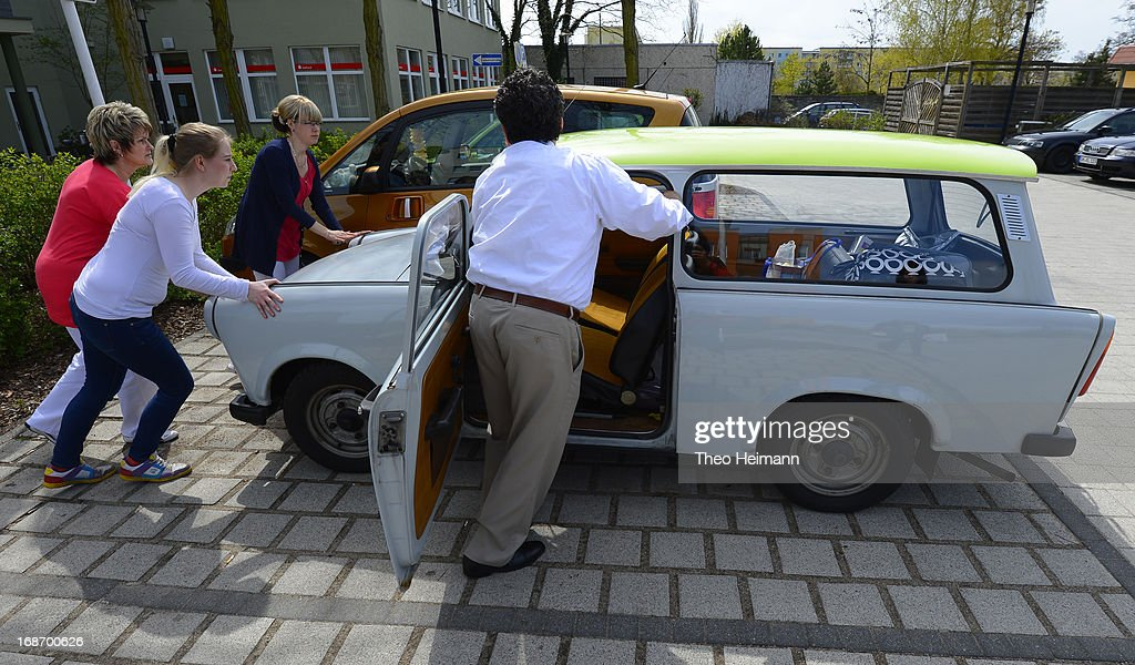 Medical doctor Amin Ballouz gets some help to start one of the five Trabant cars he owns on his way to make housecalls in surrounding villages on April 30, 2013 in Schwedt, Germany. Ballouz was born in Lebanon and moved to Germany as a child, and has had a general practitioner's practice in the small, east German town of Schwedt since 2010. Many of his patients are elderly and live in small villages in the region around Schwedt and Ballouz travels daily in one of his five Trabant cars to pay housecalls. Eastern Germany faces a chronic shortage of country doctors to serve rural communities.