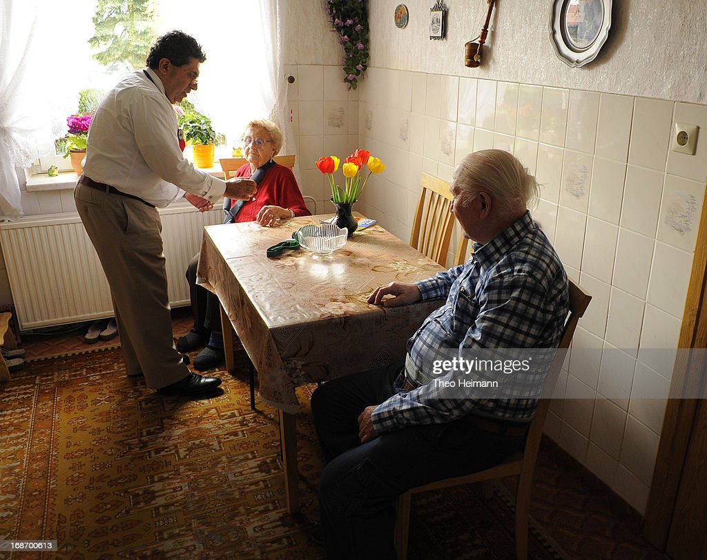 Medical doctor Amin Ballouz listens to Cristel Krause, 85, in her kitchen as her husband Wladislaw, 90, looks on during a housecall on April 30, 2013 in the village of Gratz an der Oder near Schwedt, Germany. Ballouz was born in Lebanon and moved to Germany as a child, and has had a general practitioner's practice in the small, east German town of Schwedt since 2010. Many of his patients are elderly and live in small villages in the region around Schwedt and Ballouz travels daily in one of his five Trabant cars to pay housecalls. Eastern Germany faces a chronic shortage of country doctors to serve rural communities.