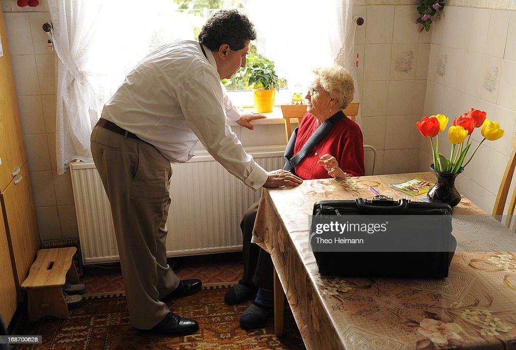Medical doctor Amin Ballouz listens to Cristel Krause, 85, in her kitchen during a housecall on April 30, 2013 in the village of Gratz an der Oder near Schwedt, Germany. Ballouz was born in Lebanon and moved to Germany as a child, and has had a general practitioner's practice in the small, east German town of Schwedt since 2010. Many of his patients are elderly and live in small villages in the region around Schwedt and Ballouz travels daily in one of his five Trabant cars to pay housecalls. Eastern Germany faces a chronic shortage of country doctors to serve rural communities.