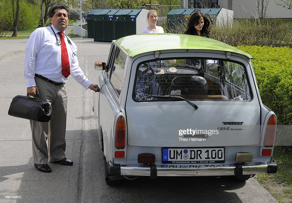 Medical doctor Amin Ballouz prepares to depart in one of the five Trabant cars he owns to make housecalls in surrounding villages on April 30, 2013 in Schwedt, Germany. Ballouz was born in Lebanon and moved to Germany as a child, and has had a general practitioner's practice in the small, east German town of Schwedt since 2010. Many of his patients are elderly and live in small villages in the region around Schwedt and Ballouz travels daily in one of his five Trabant cars to pay housecalls. Eastern Germany faces a chronic shortage of country doctors to serve rural communities.
