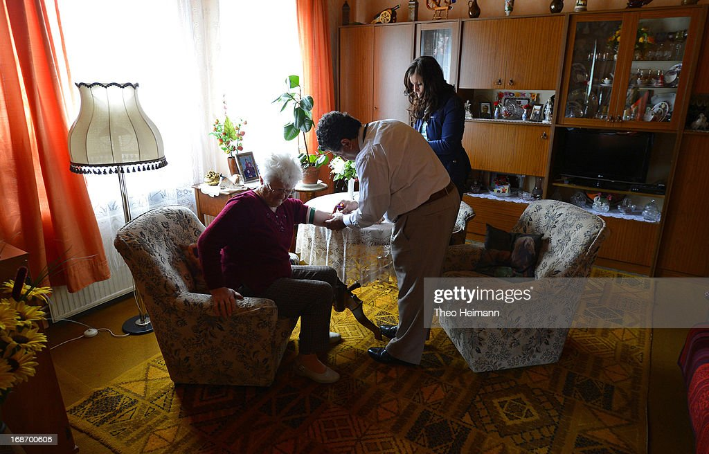 Medical doctor Amin Ballouz takes a blood sample from Cristel Krause, 85, as his assistant Nicole (R) looks on during a housecall on April 30, 2013 in the village of Gratz an der Oder near Schwedt, Germany. Ballouz was born in Lebanon and moved to Germany as a child, and has had a general practitioner's practice in the small, east German town of Schwedt since 2010. Many of his patients are elderly and live in small villages in the region around Schwedt and Ballouz travels daily in one of his five Trabant cars to pay housecalls. Eastern Germany faces a chronic shortage of country doctors to serve rural communities.