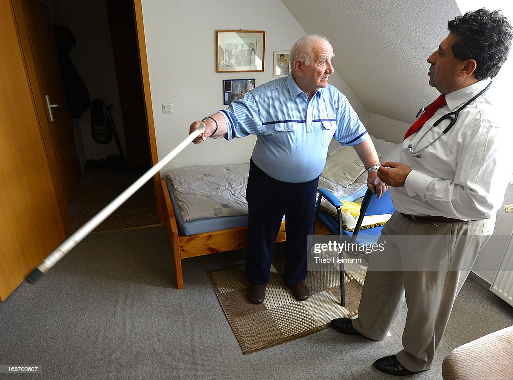 Medical doctor Amin Ballouz tends to Paul Hoeff, 90, who sees poorly and suffers from high blood pressure, during a housecall on April 30, 2013 in the village of Gartz an der Oder near Schwedt, Germany. Ballouz was born in Lebanon and moved to Germany as a child, and has had a general practitioner's practice in the small, east German town of Schwedt since 2010. Many of his patients are elderly and live in small villages in the region around Schwedt and Ballouz travels daily in one of his five Trabant cars to pay housecalls. Eastern Germany faces a chronic shortage of country doctors to serve rural communities.