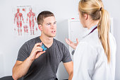 A Medical doctor applying oxygen treatment on a sporty men