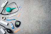 Medical equipment on gray stone background. Top view