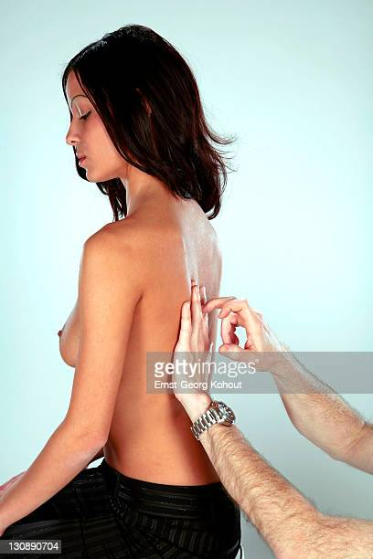 Medical examination, lung tapping (percussion) examination of a young woman's back