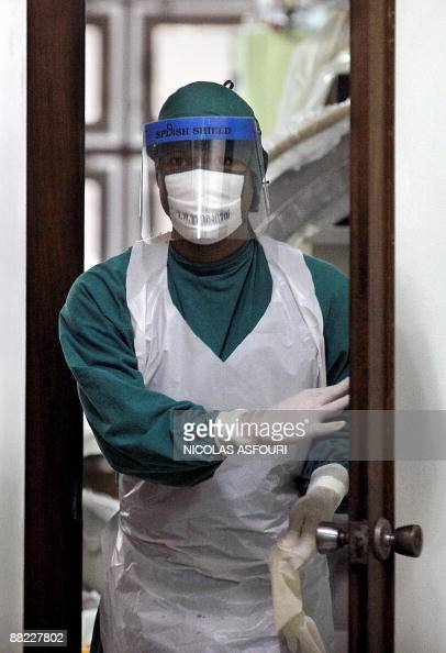 A medical examiner walks out from the autopsy room where the body of US actor David Carradine is being analysed at the Chulalongkorn hospital in...