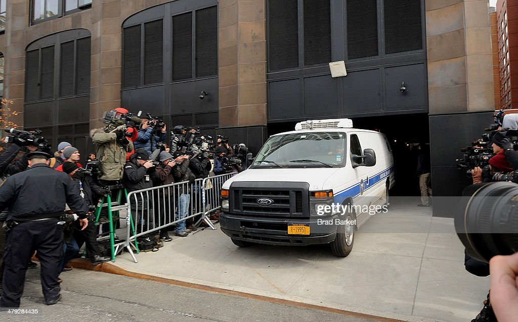 A medical examiners van leaves the scene outside the Chelsea apartment building on March 17, 2014 in New York City, where fashion designer L'Wren Scott, 47, was found dead from an apparent suicide.