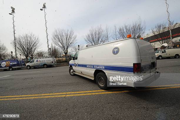 A medical examiners van leaves The scene outside the Chelsea apartment building on March 17 2014 in New York City where fashion designer L'Wren Scott...