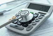 health care costs or medical insurance savings concept. stethoscope on calculator with medical billing.