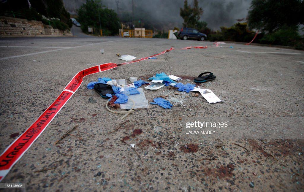 Medical gloves and material are seen lying on the floor in the Israeli settlement of Neve Ativ near Majdal Shams on the Golan Heights on June 23 at...