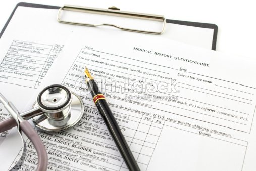 medical history questionnaire clipboard stock photo