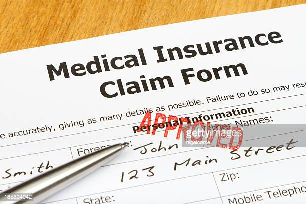 A medical insurance claim form with a red approved stamp