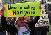 A medical marijuana activist holds a sign during a rally January 4 2010 in Oakland California Dozens of medical marijuna activists held a...