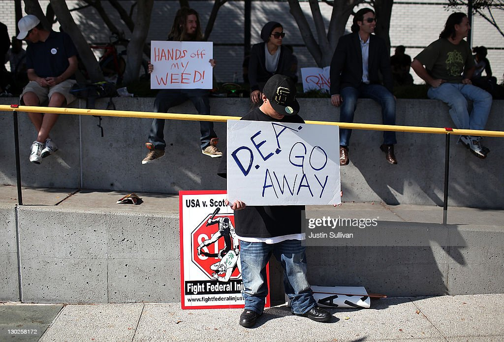A medical marijuana advocate holds a sign against the U.S. Drug Enforcement Agency as he demonstrates outside of the W Hotel where U.S. President Barack Obama was holding a fundraiser on October 25, 2011 in San Francisco, California. Hundreds of protestors from a wide variety of activist groups staged protests outside of the W Hotel where President Obama was holding a $7,500 per person fundraiser.