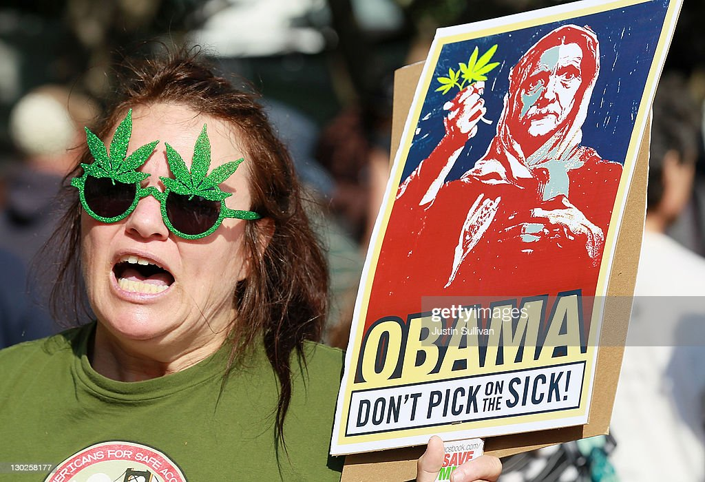 A medical marijuana advocate who goes by the name The Holy Hemptress holds a sign as she demonstrates outside of the W Hotel where U.S. President Barack Obama was holding a fundraiser on October 25, 2011 in San Francisco, California. Hundreds of protestors from a wide variety of activist groups staged protests outside of the W Hotel where President Obama was holding a $7,500 per person fundraiser.