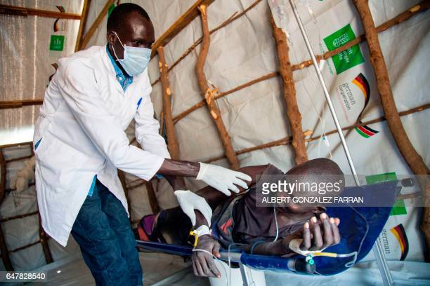 A medical officer of the International Rescue Committee examines a woman suffering from cholera on March 4 in a clinic in Ganyiel Panyijiar county in...