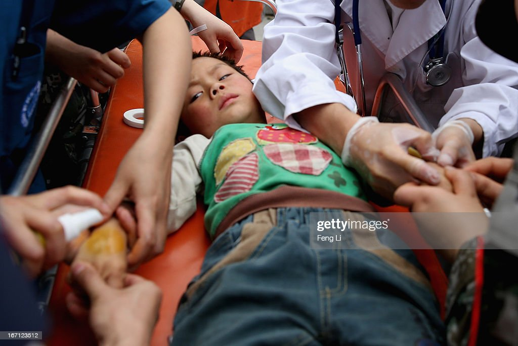 Medical officers treat a little patient at the hospital on April 21, 2013 in Lushan of Ya An, China. A magnitude 7 earthquake hit China's Sichuan province on April 20 claiming over 160 lives and injuring thousands.