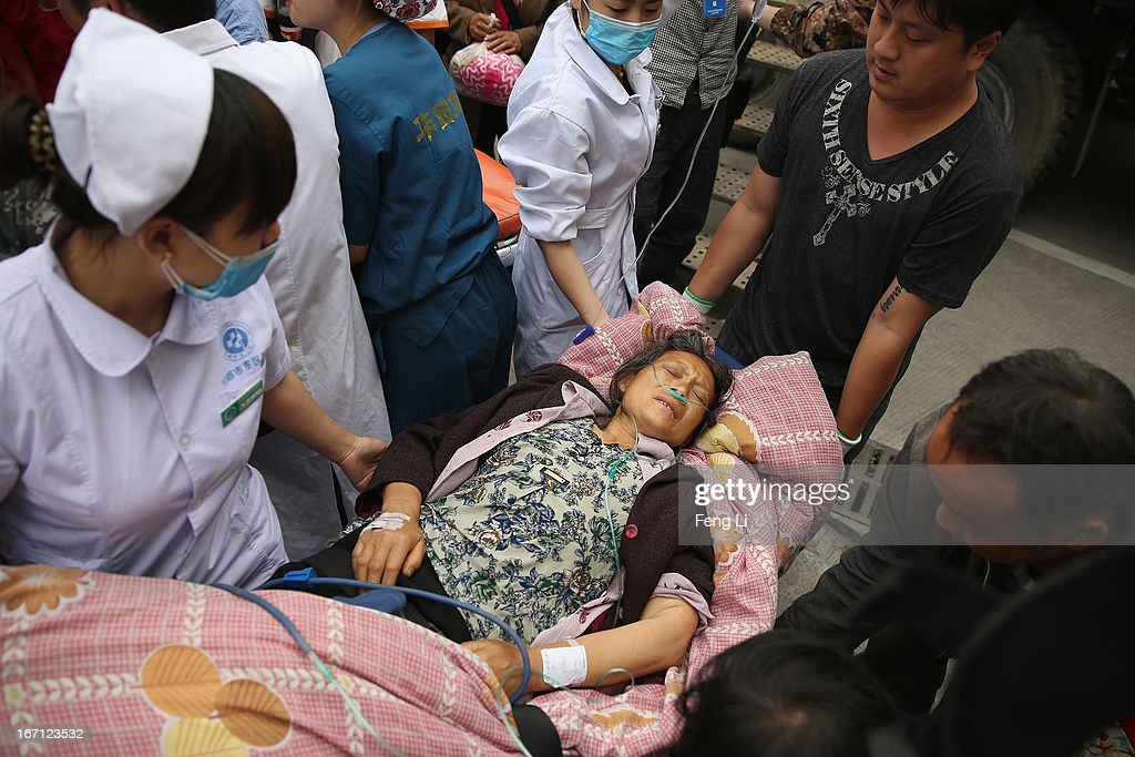 Medical officers treat a patient at the hospital on April 21, 2013 in Lushan of Ya An, China. A magnitude 7 earthquake hit China's Sichuan province on April 20 claiming over 160 lives and injuring thousands.