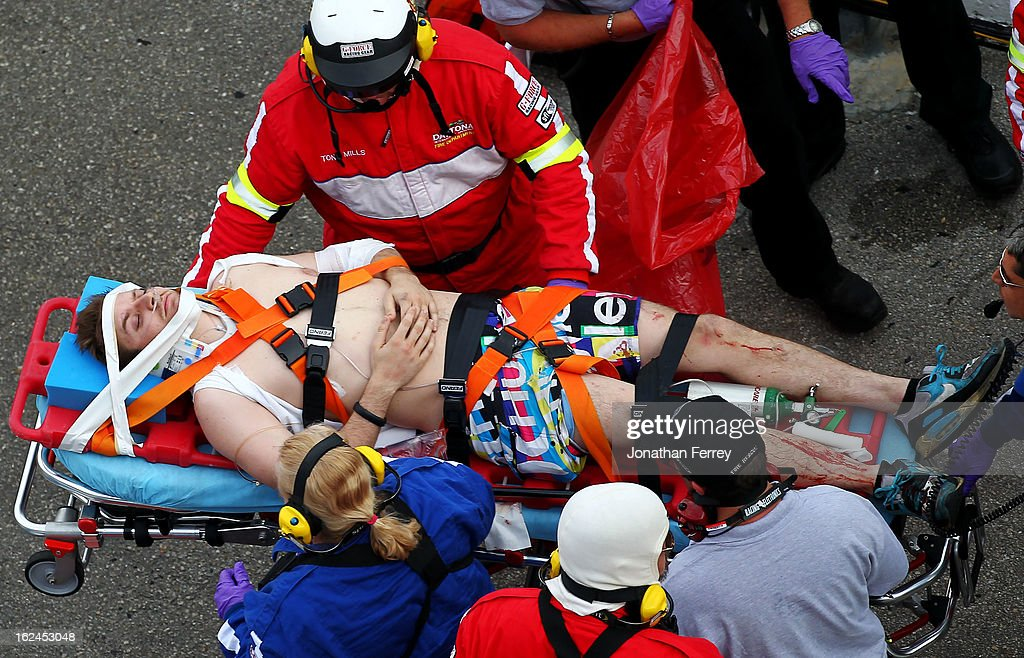 Medical officials remove an injured fan from the stands following an incident at the finish of the NASCAR Nationwide Series DRIVE4COPD 300 at Daytona International Speedway on February 23, 2013 in Daytona Beach, Florida.