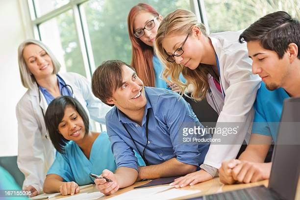 Medical or nursing students working together on patient case