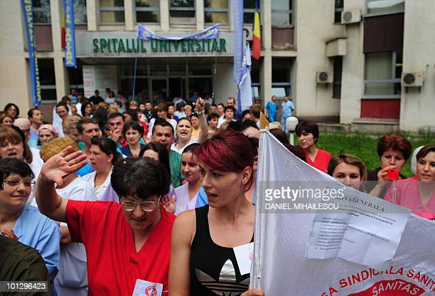 Medical personel and employees of the University Hospital in Bucharest shout antigovernment slogans during a protest in front of the hospital in...