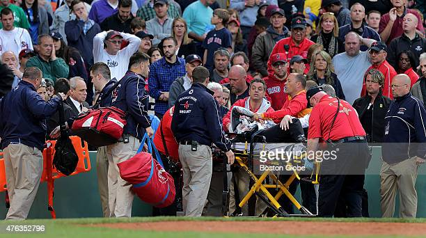 Medical personnel remove a fan injured by a broken bat in the second inning The Boston Red Sox take on the Oakland Athletics in Game one of a three...